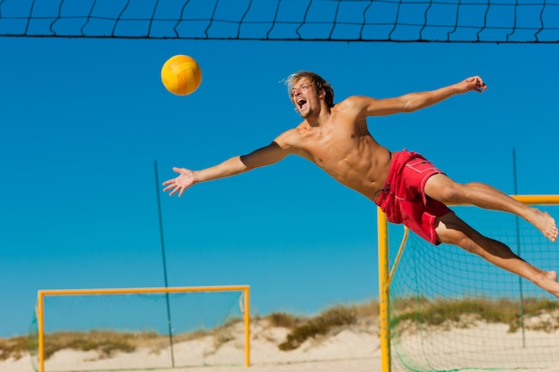 Beach volleyball - man jumping Premium Photo