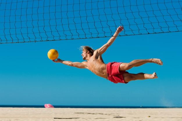 Beach volleyball - man jumping Premium Photo