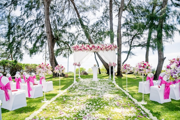 Beach wedding venue arch, altar decorated with pink, white ...