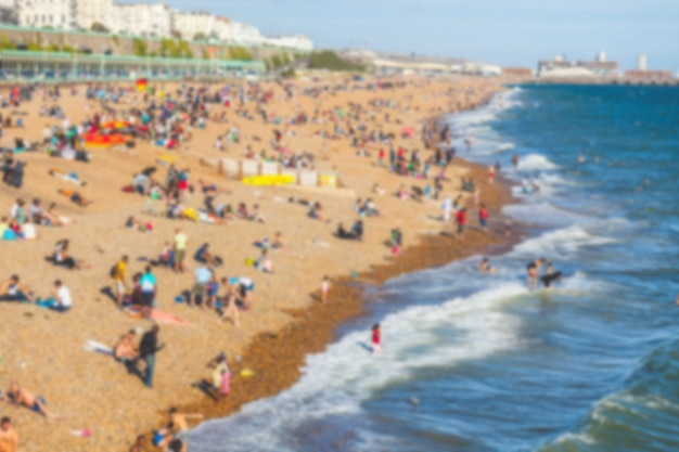 Beach with people sunbathing Premium Photo