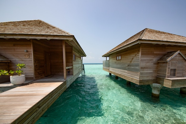 Beach with water bungalows at maldives Premium Photo