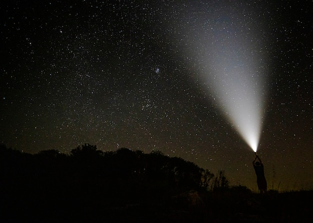 Beam of light in the starry night sky Free Photo