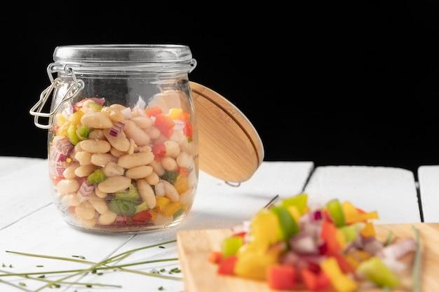 Bean salad mix in a jar black background Premium Photo