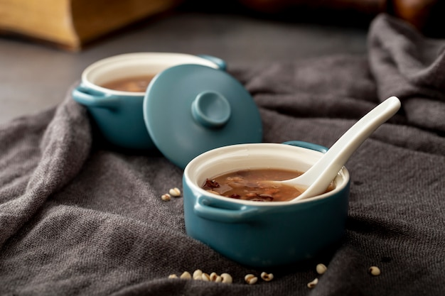 Bean soup bowls on a grey cloth Free Photo