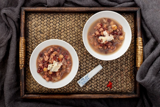 Beans soup in a jars on a wooden tray Free Photo
