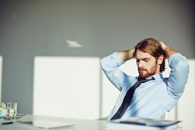 Bearded businessman thinking | Free Photo