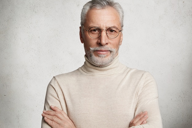 Bearded grey-haired elderly man wearing turtleneck Free Photo