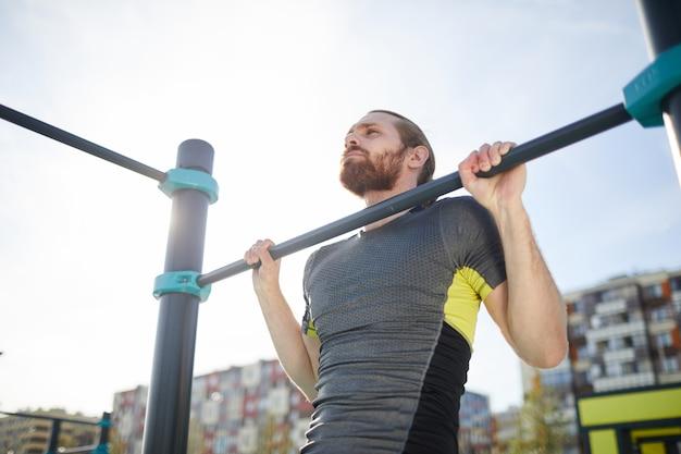 Premium Photo | Bearded man hanging on outdoor bar
