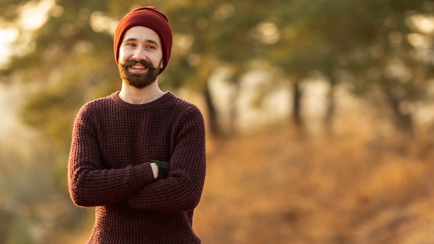 Bearded man posing in nature Free Photo
