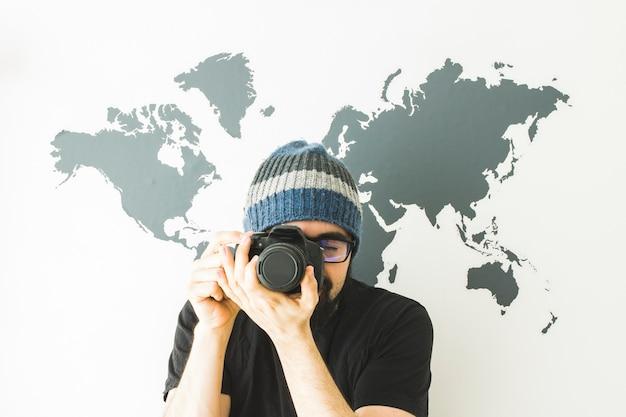Bearded man on white background with world map Premium Photo