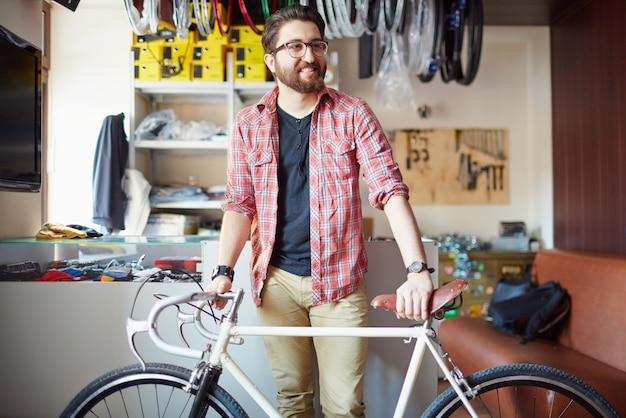 Bearded man with bicycle Free Photo