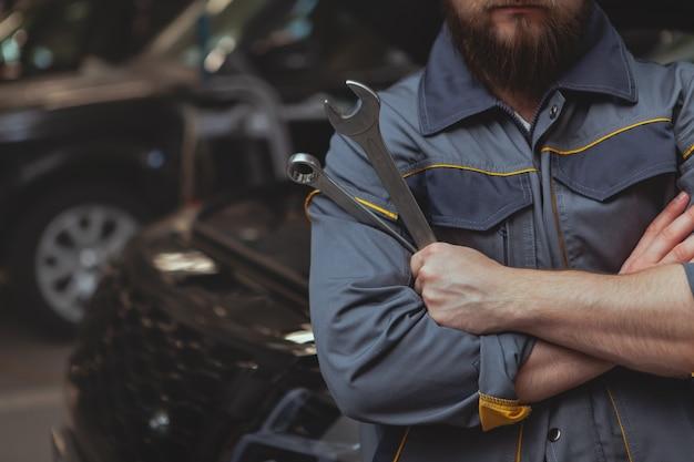 Bearded mechanic working at car service station Premium Photo