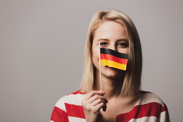Beatiful girl holds german flag Premium Photo