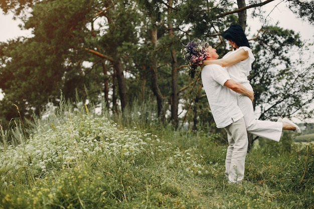 Beautiful adult couple spend time in a summer field Free Photo