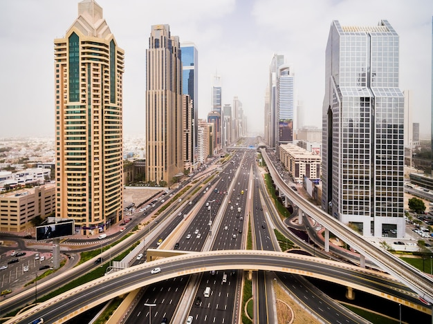Beautiful aerial view of futuristic city landscape with roads and cars and skyscrapers Premium Photo