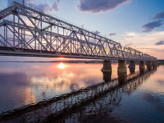 Beautiful aerial view of the railway bridge across the volga river at sunset Premium Photo