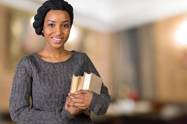 Beautiful afro american woman holding books Premium Photo