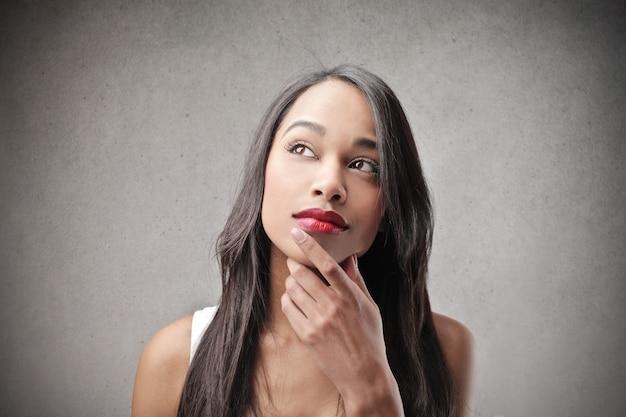 Beautiful afro woman wondering Premium Photo