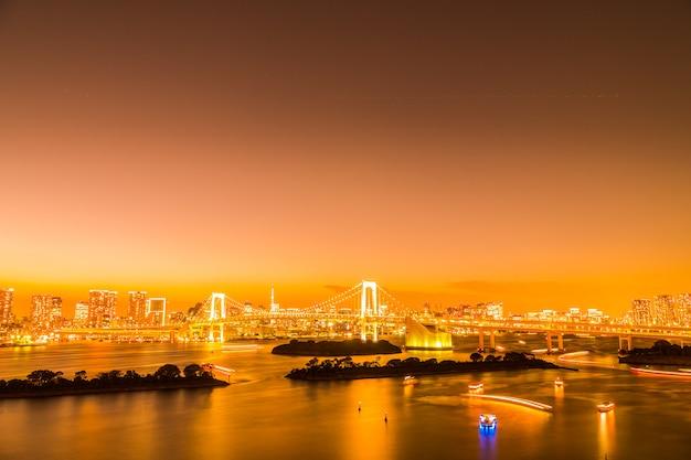 Beautiful architecture building cityscape of tokyo city with rainbow bridge Free Photo