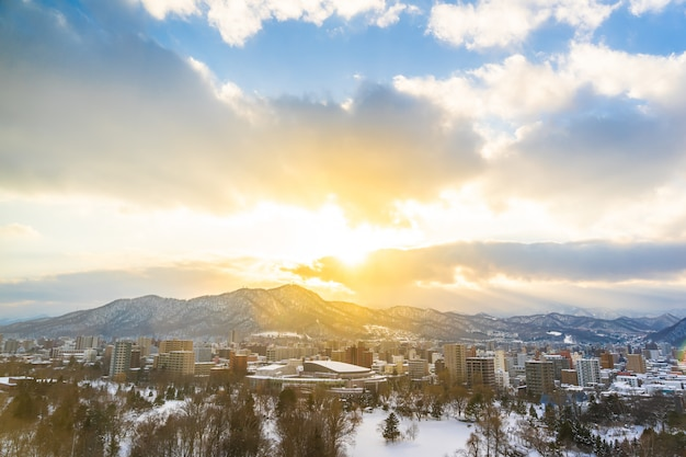 Beautiful architecture building with mountain landscape in winter season at sunset time Free Photo