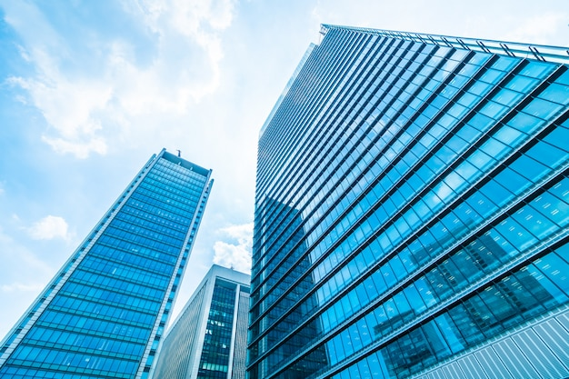 Beautiful architecture office building skyscraper with window glass pattern Free Photo