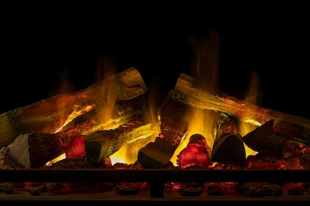 A beautiful artificial fireplace close-up Premium Photo