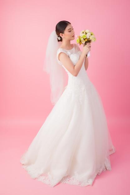 Beautiful asian bride portrait in pink Free Photo