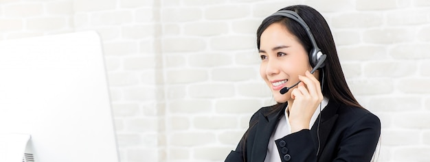 Beautiful asian businesswoman working in call center as an operator Premium Photo