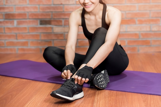 Beautiful asian fitnesses woman is exercise at home Premium Photo