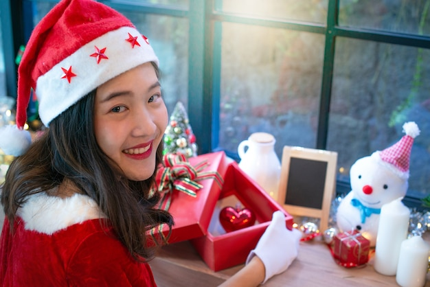 Beautiful asian girl in christmas wearing and santa hat dc4a14c2676