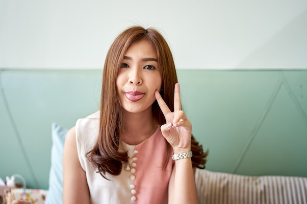 Beautiful asian girl peeking through fingers stock photo