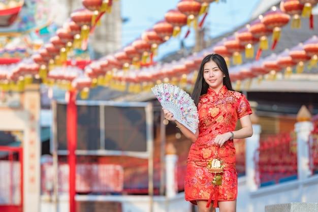 Beautiful asian model wearing traditional cheongsam.happy chinese new year Premium Photo