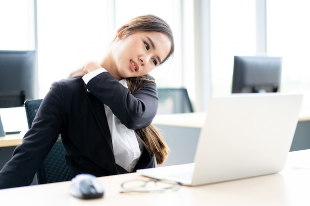 Beautiful asian office woman having an office syndrome problem Premium Photo