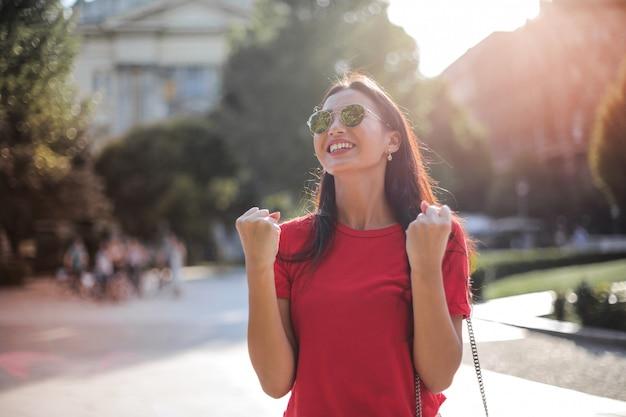 Beautiful asian woman feeling successful Premium Photo