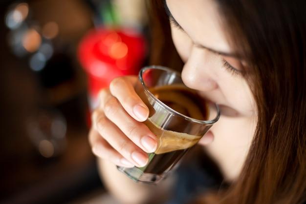 Beautiful asian woman is drinking coffee Premium Photo
