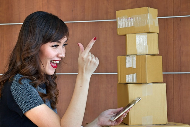 A beautiful asian woman is working packing product to selling online. Premium Photo