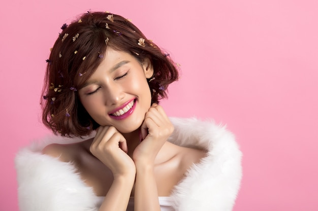 Beautiful asian woman isolated on pink Free Photo