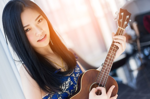 Asian Dating Attractive Asian Girl Playing Ukulele High