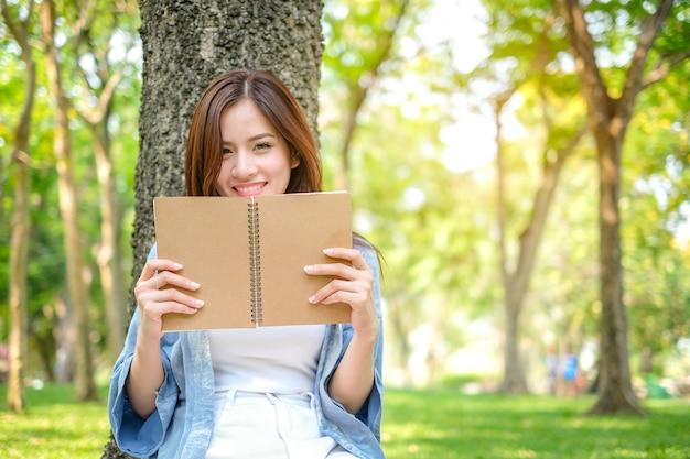 Beautiful asian woman reading book Premium Photo
