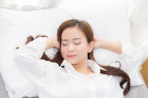 Beautiful asian woman sleeping lying in bed Premium Photo