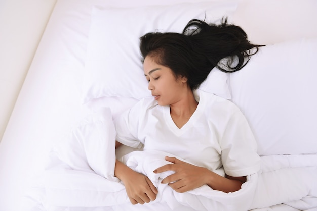 Beautiful asian woman sleeping with comfortably Premium Photo