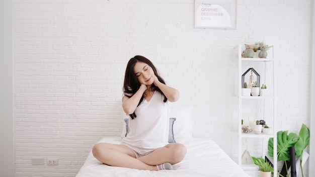 Awe Inspiring Beautiful Asian Woman Stretching Her Body After She Wake Up Home Interior And Landscaping Ologienasavecom