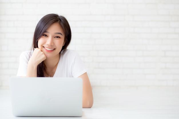 Beautiful asian woman working online laptop Premium Photo