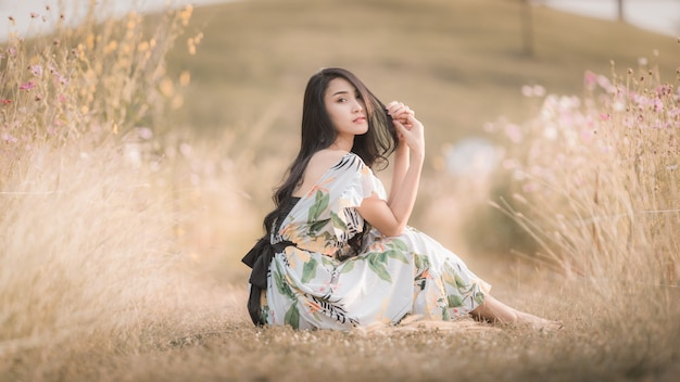 Beautiful asian women girl sitting posing in the park flower picture style vintage Premium Photo