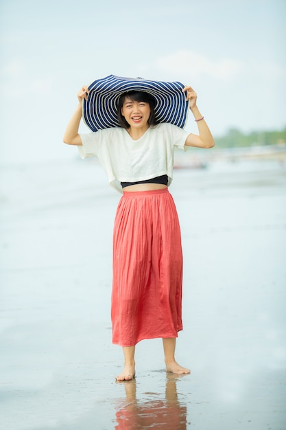 Beautiful asian younger woman happiness on vacation sea beach Premium Photo