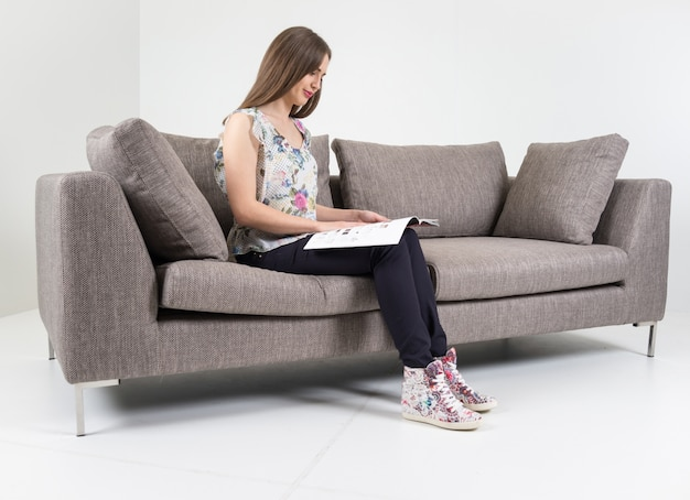 Fabulous Beautiful Attractive Girl Sitting On Modern Sofa In White Squirreltailoven Fun Painted Chair Ideas Images Squirreltailovenorg