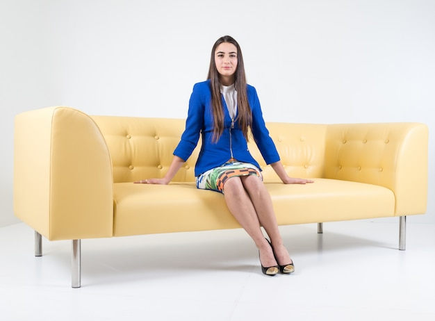 Astounding Beautiful Attractive Girl Sitting On Modern Sofa In White Squirreltailoven Fun Painted Chair Ideas Images Squirreltailovenorg
