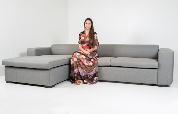 Outstanding Beautiful Attractive Girl Sitting On Modern Sofa In White Squirreltailoven Fun Painted Chair Ideas Images Squirreltailovenorg