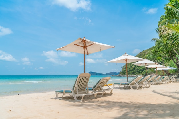 Beautiful beach chairs with umbrella on tropical white sand beac Free Photo