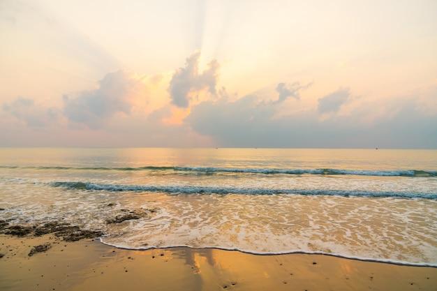 Beautiful beach and sea on sunrise time Free Photo